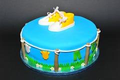 Baby shoes baptism celebration cake Stock Photography