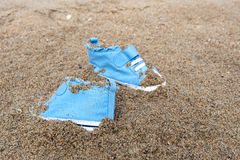 Baby shoes on beach Royalty Free Stock Photography