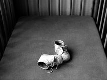 Baby shoes - black and white. Pair of old tiny baby shoes. Black and white with copyspace Stock Photography