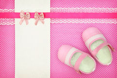 Baby shoes and blank banner Stock Photo