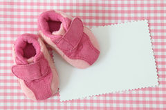 Baby shoes and blank note Royalty Free Stock Photos