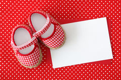 Baby shoes and blank note Royalty Free Stock Photography