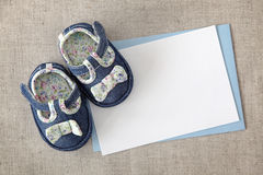 Baby shoes and blank note Royalty Free Stock Images