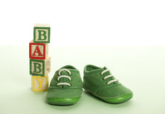 Baby shoes and blocks Stock Photos