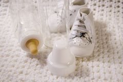 Baby Shoes and Bottle Stock Photography