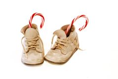 Baby Shoes and Candy Canes Royalty Free Stock Photography