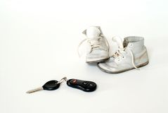 Baby Shoes and Car Keys Royalty Free Stock Photos