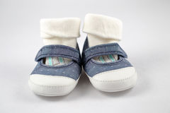 Baby shoes. Close up of baby shoes on white background Royalty Free Stock Images