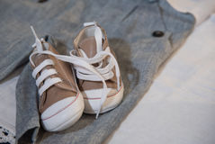 Baby shoes and clothes Royalty Free Stock Photography