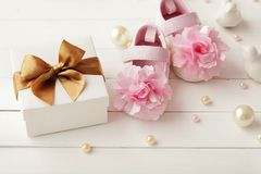 Baby shoes and gift box. Close-up of baby shoes and gift box. baby birth decoration royalty free stock photo