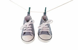 Baby shoes hanging Royalty Free Stock Images