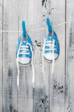 Baby shoes hanging on the clothesline. Royalty Free Stock Photography