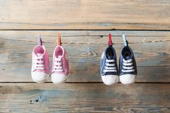 Baby shoes hanging on the clothesline. Stock Photo