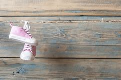 Baby shoes hanging on the clothesline. Royalty Free Stock Image