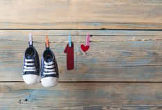 Baby shoes hanging on the clothesline. Stock Image