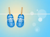 Baby shoes hanging Royalty Free Stock Photo