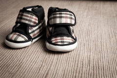 Baby shoes. Isolate in sepia tone Stock Image