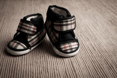 Baby shoes. Isolate in sepia tone Royalty Free Stock Images