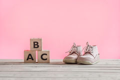 Baby shoes learning how to walk Royalty Free Stock Image