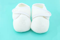 Baby shoes. On light blue background Stock Photo
