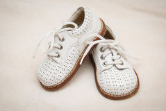 Baby shoes. Little baby white leather shoes Stock Photo