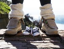 Baby shoes and mother shoes outdoors on a stairs Stock Photography