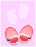 Baby shoes. Newborn baby shoes with footprints Stock Photos