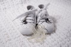 Baby Shoes with Pacifier royalty free stock photos