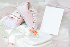 Baby shoes and pacifier on diapers. Photo Frame Stock Image
