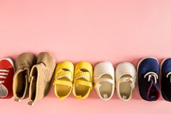 Baby shoes on a pink background stock photo