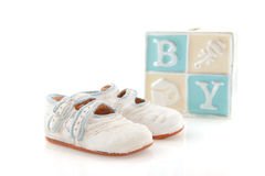 Baby shoes and piggy bank Stock Photography