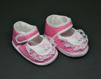 Baby shoes pink. Pink Baby shoes for girl on black background Stock Photography