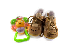Baby shoes and rattle Royalty Free Stock Image