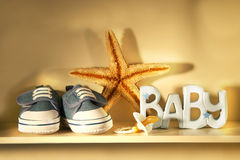 Baby shoes on the shelf Stock Image