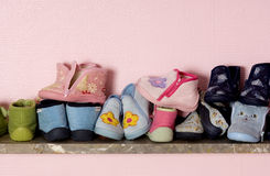 Baby shoes on a shelves Royalty Free Stock Photos
