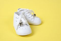 Baby Shoes Together on Yellow Royalty Free Stock Photo