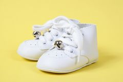 Baby Shoes Together on Yellow Stock Photo