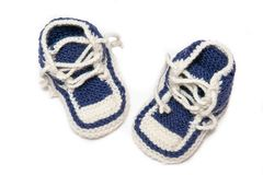 Baby shoes on white background stock photo