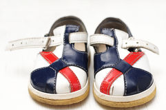 Baby shoes white,blue and red colored Royalty Free Stock Images