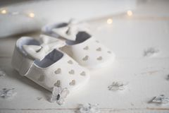 Baby shoes on vintage background Royalty Free Stock Image