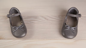 Baby shoes on wood background small Stock Photography