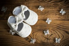 Baby shoes. On wooden table Stock Photos