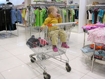 Baby in shop Royalty Free Stock Photos