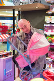 Baby shop buying stroller Royalty Free Stock Image