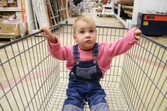 Baby in shop carriage Stock Photos