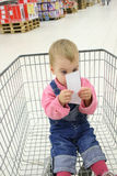 Baby in shopingcart Stock Photo