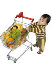 Baby with shopping cart Stock Image