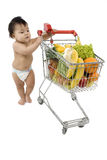 Baby with shopping cart Stock Photos