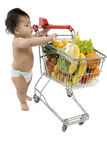 Baby with shopping cart Royalty Free Stock Image