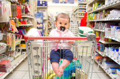 Baby shopping cart newborn supermarket Royalty Free Stock Images
